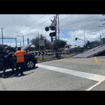 tow truck blocking train tracks